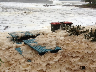 Yamba covered in sea foam after storm.