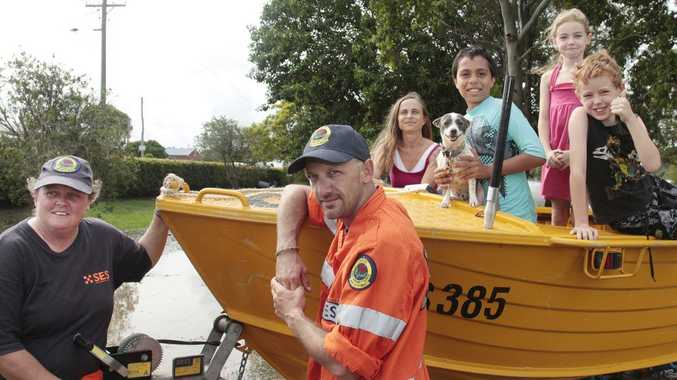SES volonteers Carmen Wells and Terry Collins with rescued family, from left, Keturah Grech, Caleb Winbye (10) holding Rex his dog, and friends Ruby Scott (7) and Ben Scott (9) from Bungawalbin. Photo Mireille Merlet-Shaw / The Northern Star