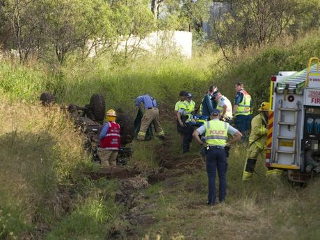 Emergency services attend a single vehicle rollover on a dirt road off Carrington Rd.