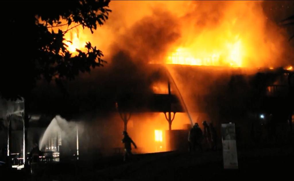 Firefighters work to save Uki's pub, the Mt Warning Hotel, on Saturday night. It's believed the pub caught fire again on Monday morning.