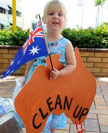 Clean Up Australia Day volunteer Olivia Harrison, 2, prepares to help clean up.