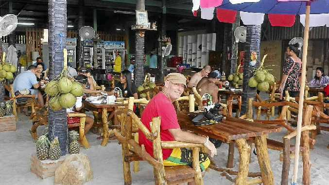 Garry Williamson relaxes at the Sangaroon Seafood bar on Tawaen beach.