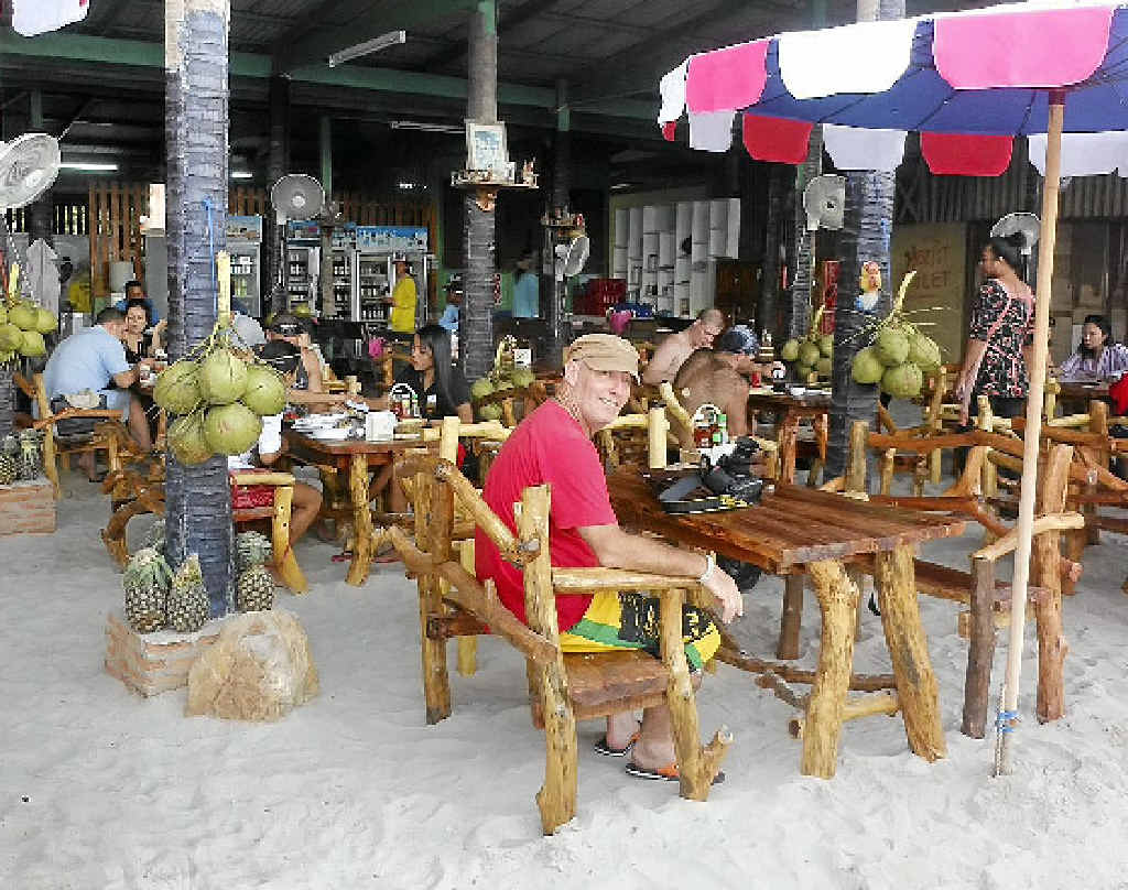 Garry Williamson relaxes at the Sangaroon Seafood bar on Tawaen beach.
