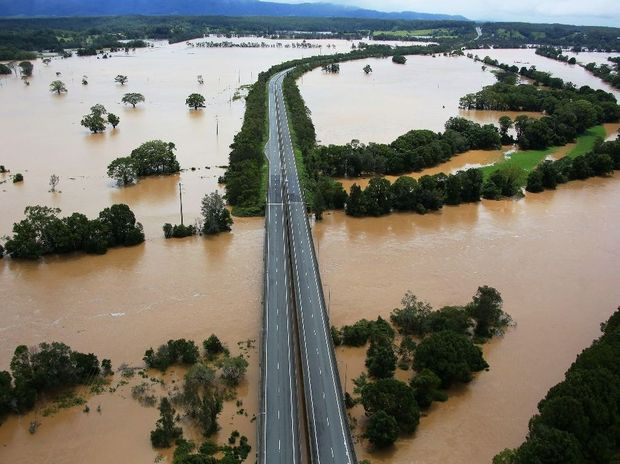 This shot taken over the Bellingen overpass and looking back towards Coffs Harbour shows the flooding of the Bellinger River alongside the Pacific Highway.
