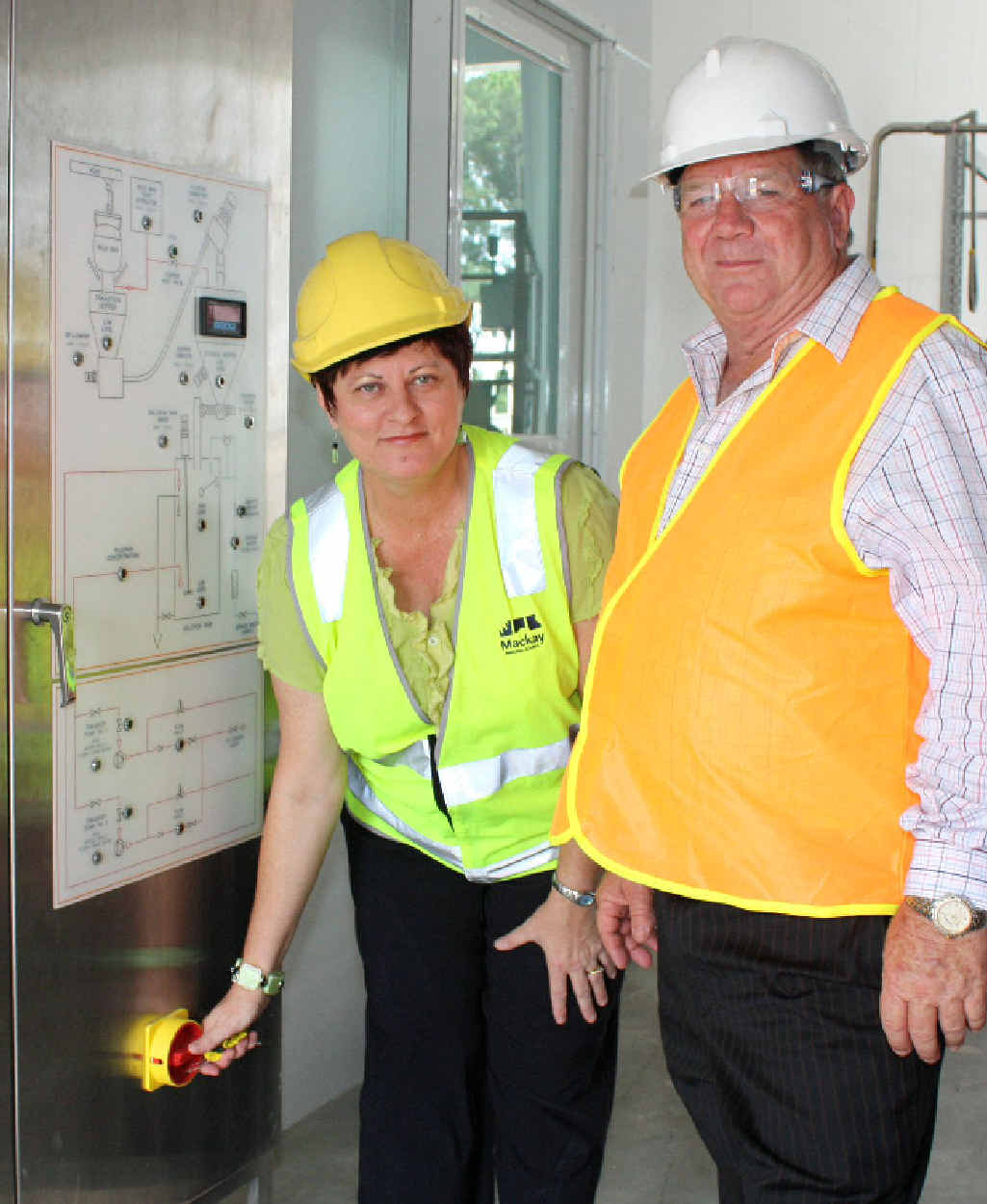 Cr Comerford with then-mayor Col Meng doing final checks just days before fluoride was put into Mackay's water system back in December 2009.