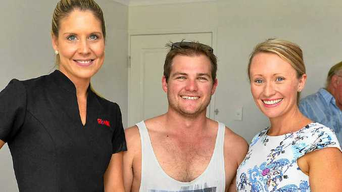 Kate Vicente, and Chris and Alicia Williams check out the Peet Charity House in Gladstone on Saturday.