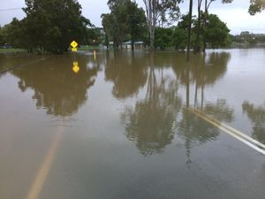 Flood waters play havoc with Queensland roads