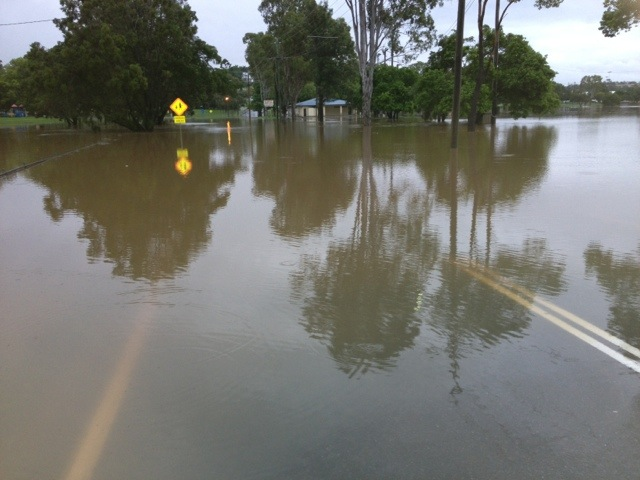 Floodwater over Brisbane Road at One Mile near Gympie.
