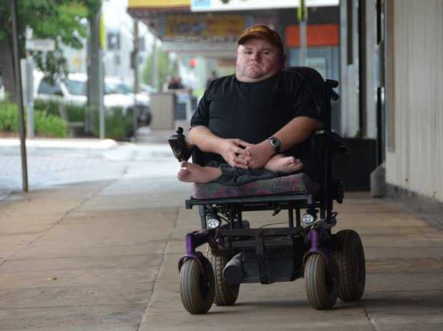 DISREGARDED: Craig Lucas wants businesses to know the effects no wheel-chair access at store entrances can have on the lives of the disabled and elderly.