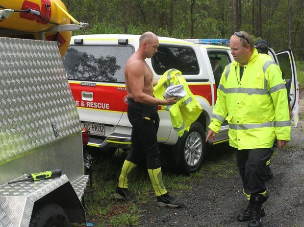 A WOMAN found safe this morning after beng lost in bushland near Pomona had been attempting to get home through a forest after her car was hit by rising floodwaters. Swift water rescue personell return to their vehicles after their successful search.