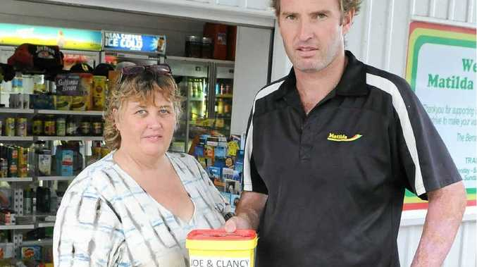 Family friend Debbie Whittle and Matilda Goomboorian service station owner Ben Bernard.