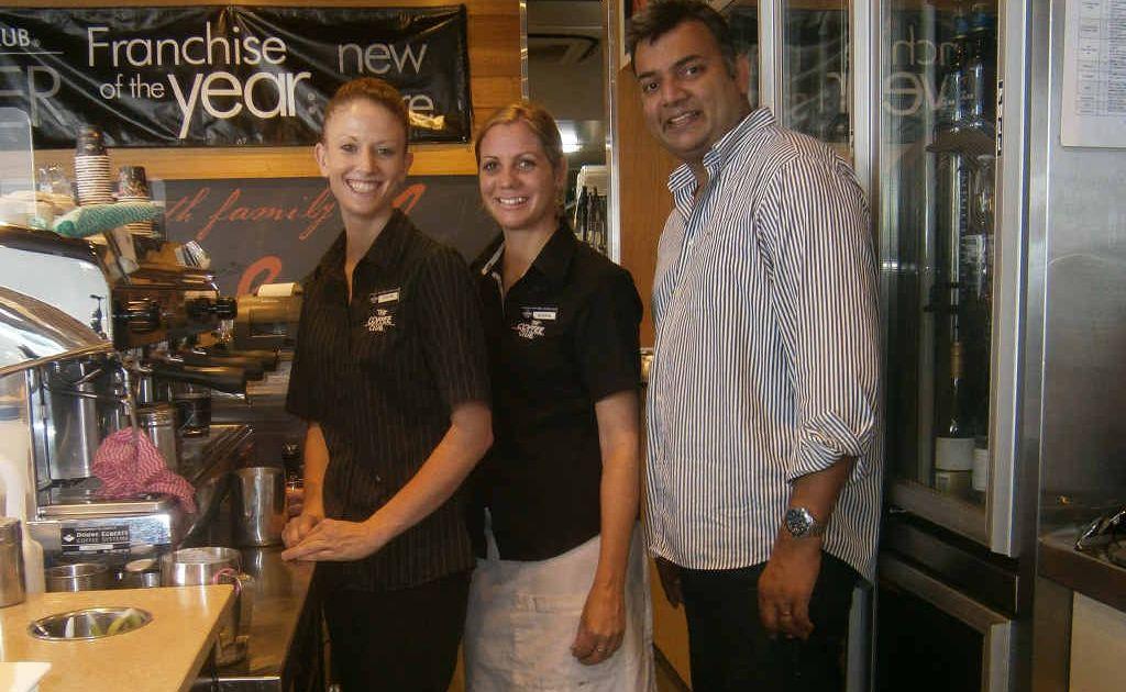 CUP HALF-FULL: Chloe Mcdermaid, Shone Emanuel and Ravi Ramswarup from The Coffee Club Yeppoon Esplanade celebrate the store's big win.