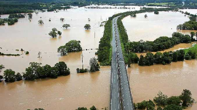An aerial view of the Pacific Hwy at Urunga shows the extent of flooding.