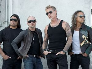 Metallica rocks into surf store for boardies, staff stunned