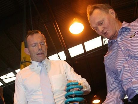 Opposition leader Tony Abbott with Glen Dobinson at Dobinson Springs while visiting Rockhampton.