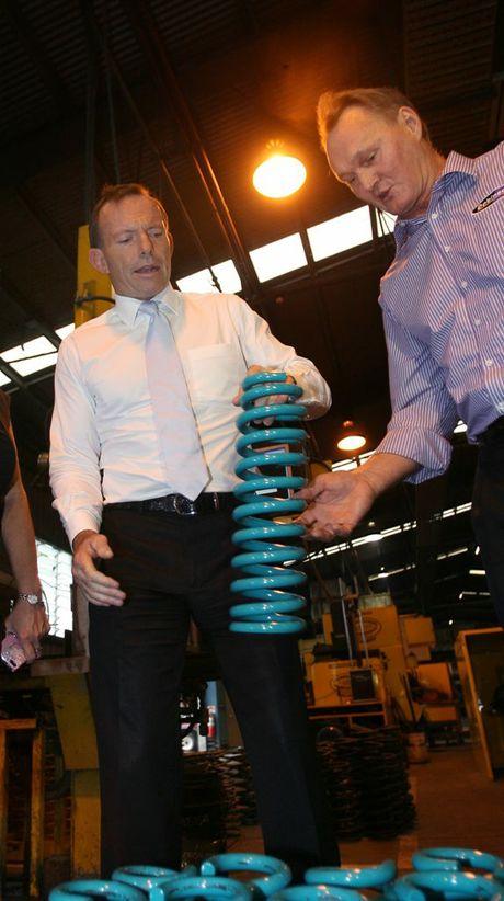 Opposition leader Tony Abbott with Glen Dobinson at Dobinson Springs while visiting Rockhampton.