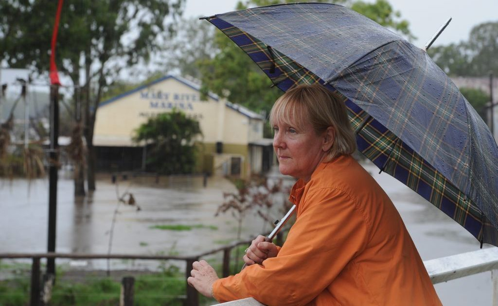 HARD RAIN- Shelly Reid walks by the river rain, hail or shine but today she rues the crazy weather that prevents her from visiting her grandson who was born today. Photo: Robyne Cuerel / Fraser Coast Chronicle
