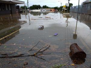 Receding floodwater reveals road damage, hazards