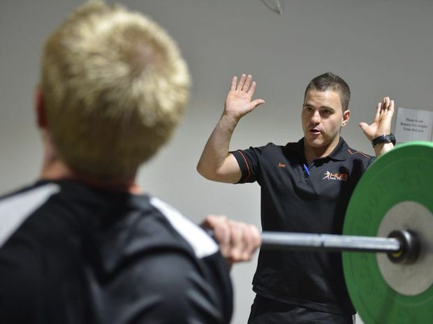 HUB Total Fitness personal trainer manager Sam Fowler and Brendan Fischer work out.