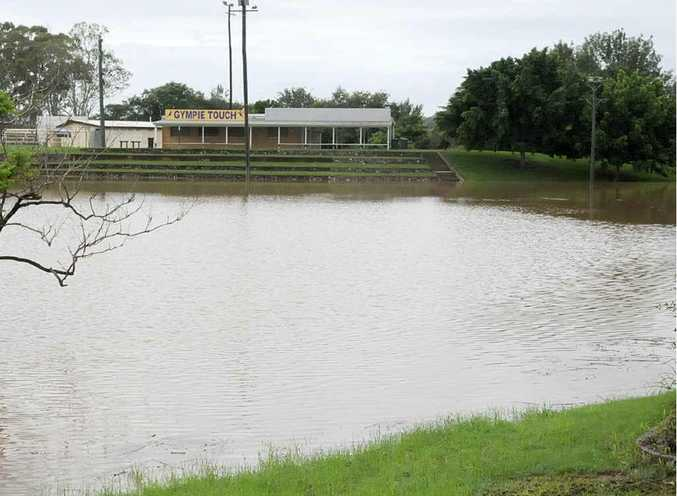 Mary River floodwaters creep up towards the Gympie Touch clubhouse yesterday.