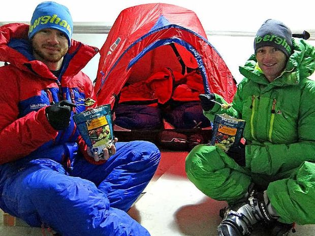 Adventurers Evan Howard and John Cantor test their new down suits and sleeping bags in a freezer.