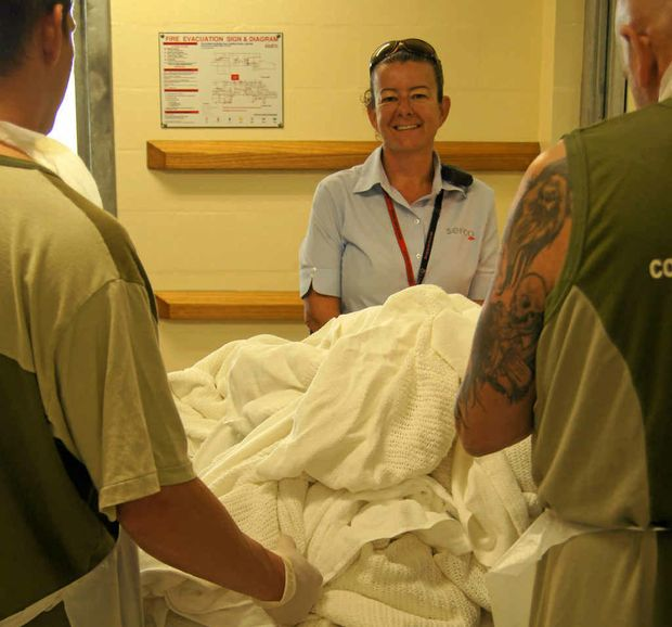 SQCC HELP: Tara Robinson monitors offenders from the Southern Queensland Correctional Centre processing the laundry.
