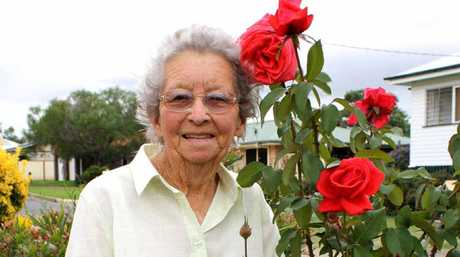 Merle Bamberry with one of many of her beautiful plants.