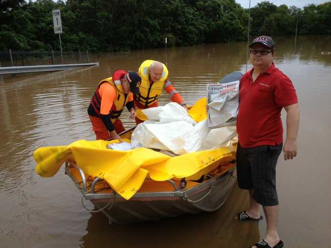 Gympie Times comes in by boat after the town was hit by flooding again overnight. The Mary River peaked at about 18.44 metres this morning. Papers are available from Southside locations.