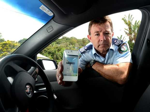 Sgt of Crime coordinator Stuart Crawford with an iphone map.