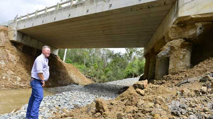 Agforce regional representative Leo Neill-Ballantine stands near the structurally damaged bridge on the Dawson Hwy, just west of Calliope.