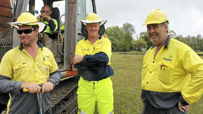 POTTY HUMOUR: Council workers Dean Watson, Robert Pyne and Trevor Foster battle the elements while repairing a collapsed sewer main next to Richmond River High School on Tuesday.