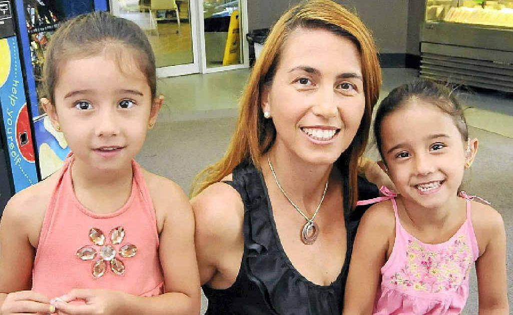 GRATEFUL RECIPIENT: Sarah Carroll (left), her twin Katrina (right) and mum Nena Carroll.