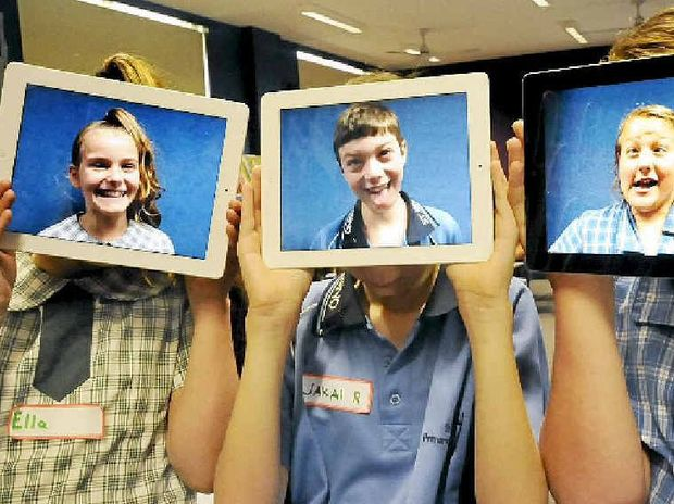 MULTI-TALENTED: Ella Robinson, 11, and Jakai Reddell, 12, from St Joseph's Woodburn, and Georgie Lee Bowden, 12, from St Mary's Casino having fun with their iPads at a multimedia enrichment day.