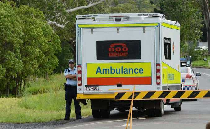 An ambulance waits while a teenage girl is treated after leaping from a moving car.