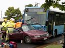 TWO men are in a critical condition after their car slid on wet roads and crashed side-on into an oncoming bus in Wilsonton.