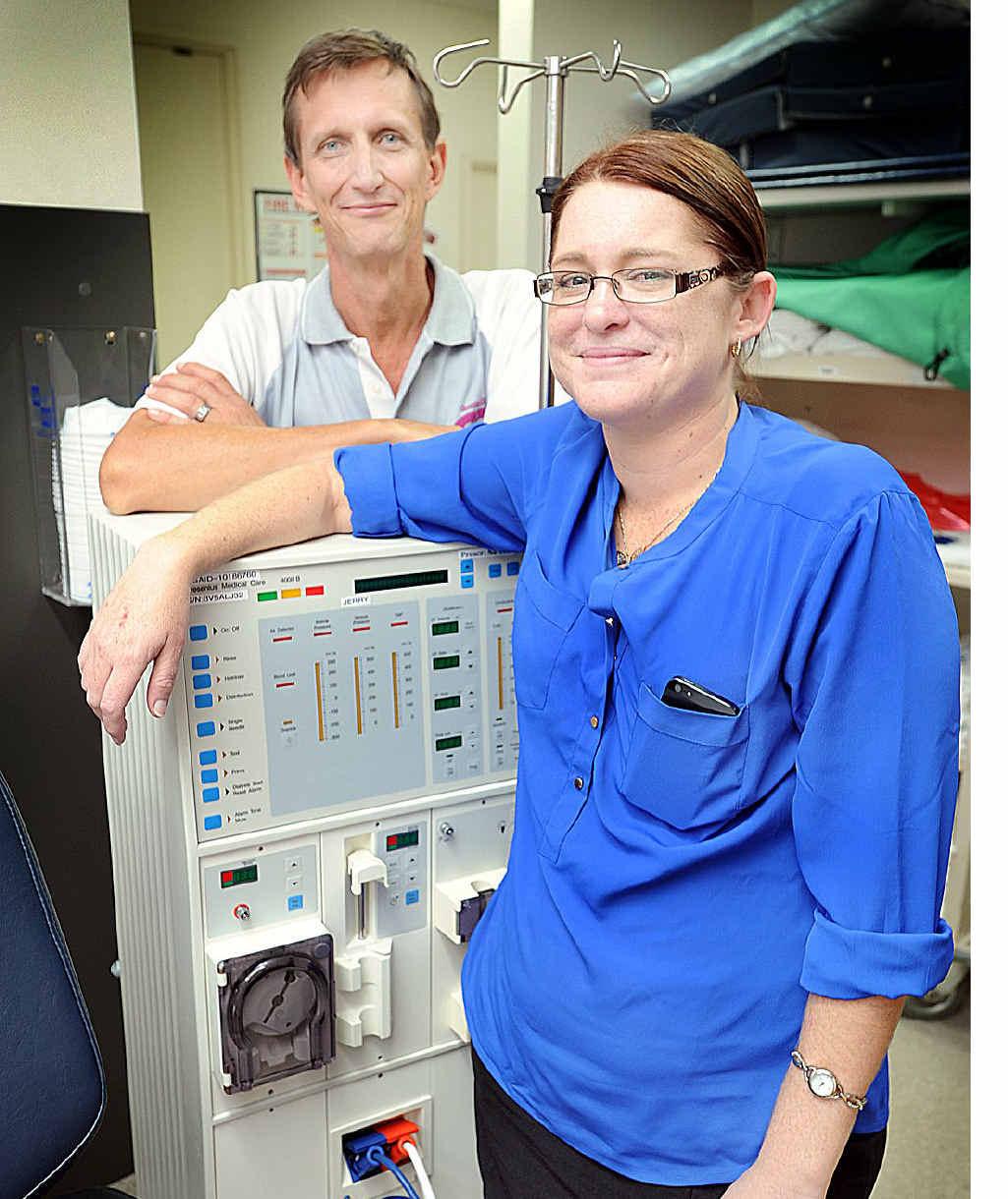 NEW LIFE: Kidney and pancreas transplant patient Megan Jonas with nurse consultant Ian Rogers.