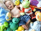 SALE TIME: Six-month-old Caspian Manly has a sneak peek at toys and clothes destined for the St Joseph's Baby and Kidz Bazaar.