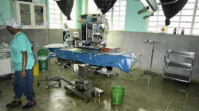 OPERATING THEATRE: Dr Kelsey of Toowoomba volunteered at the Selian Hospital in Tanzania.