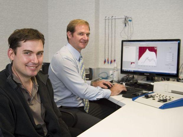 Adam Cojean (left) has his Med El Bonebridge implant turned on by audiologist Dominic Doherty.