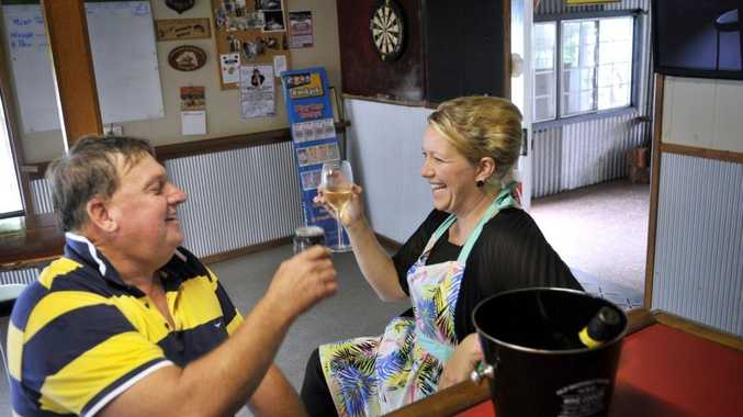 New owners of Carbarlah's Farmers Arms Hotel Wayne and Linda Franklin raise a cold one to their new venture.