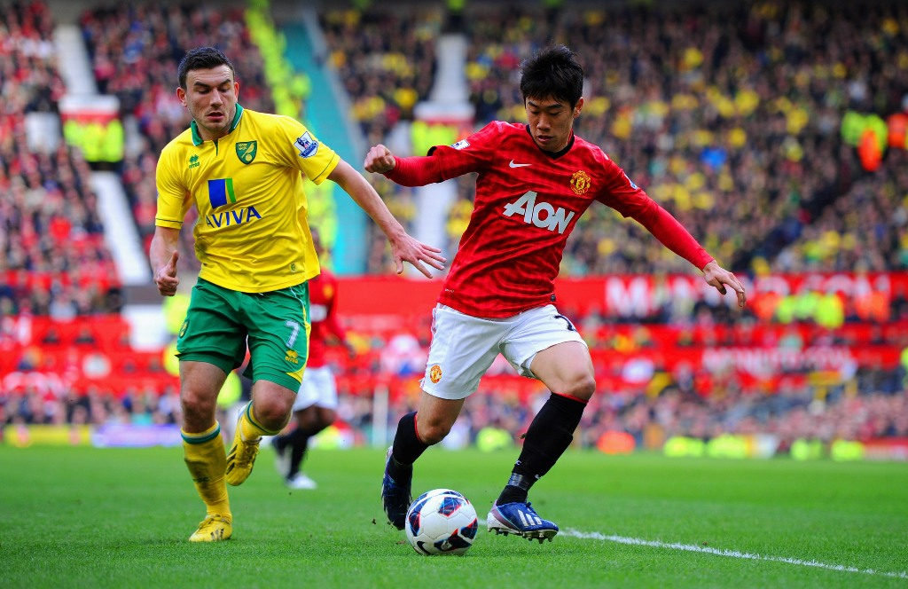 Shinji Kagawa of Manchester United in action with Robert Snodgrass of Norwich during the Barclays Premier League match between Manchester United and Norwich City at Old Trafford on March 2, 2013 in Manchester, England.