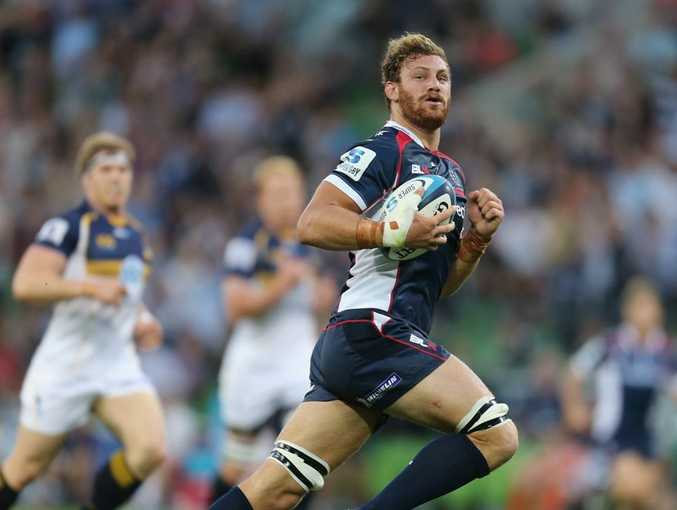 Scott Higginbotham of the Rebels runs in to score the Rebels first try of the game during the round two Super Rugby match between the Rebels and the Brumbies at AAMI Park on February 22, 2013 in Melbourne, Australia.