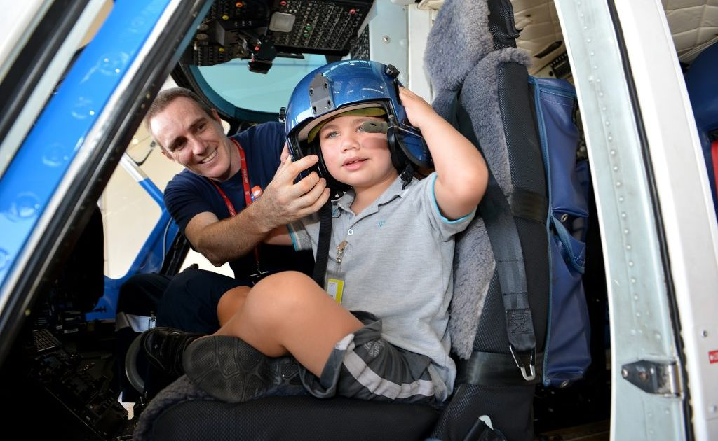 Angus Bowles thanks AGL Action Rescue Helicopter crewman Daniel King for his assistance in a medical emergency.