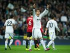 Cristiano Ronaldo of Real Madrid celebrates scoring his sides equalizing goal during the UEFA Champions League Round of 16 first leg match between Real Madrid and Manchester United at Estadio Santiago Bernabeu on February 13, 2013 in Madrid, Spain.