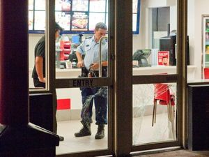 Police on man hunt after Red Rooster raided by robbers