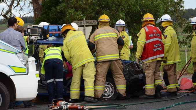 JAWS OF LIFE: Emergency services personnel work to free a woman trapped in her vehicle following a traffic crash just north of Kingaroy this morning.
