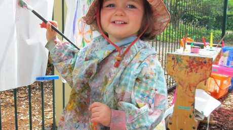 Sophia White paints a Picasso at Barrel of Babes Playgroup. Contributed March 2013