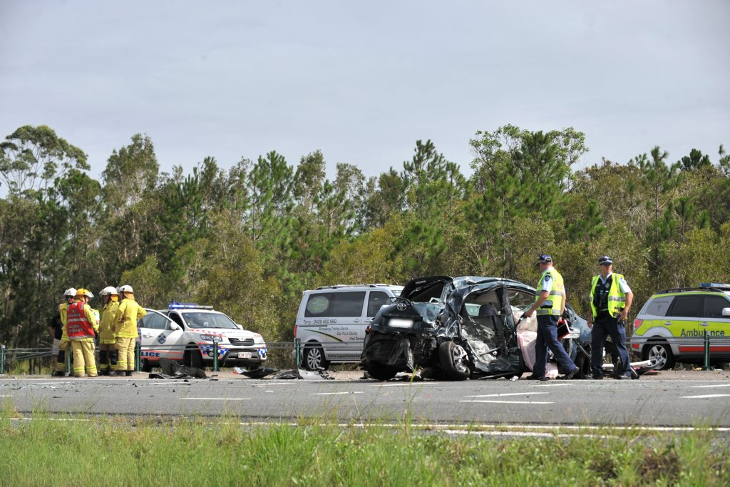 Police attend the scene of a fatal accident on the Sunshine Motorway.