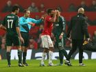 Referee Bahattin Duran sends off Nani of Manchester United during the UEFA Champions League Round of 16 Second leg match between Manchester United and Real Madrid at Old Trafford on March 5, 2013 in Manchester, United Kingdom.
