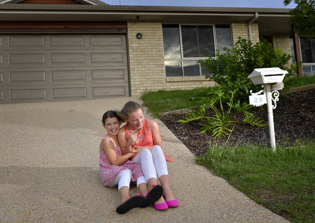 HAPPY FAMILIES: Emmadale Gardens residents Zoe, 8, and Hannah McEvoy, 11.